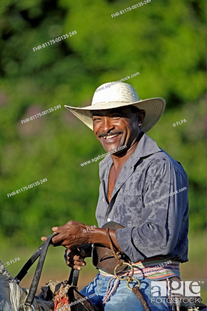 915bed550dd27 Stock Photo - Pantanal cowboy
