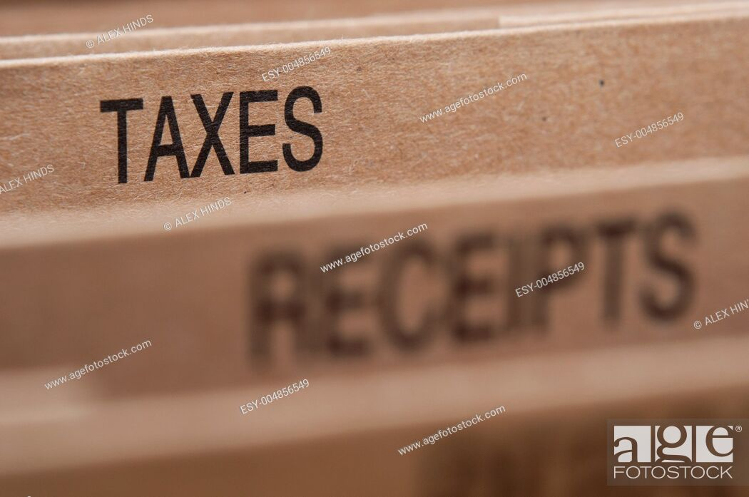 Stock Photo: Tax section tab in folding file.