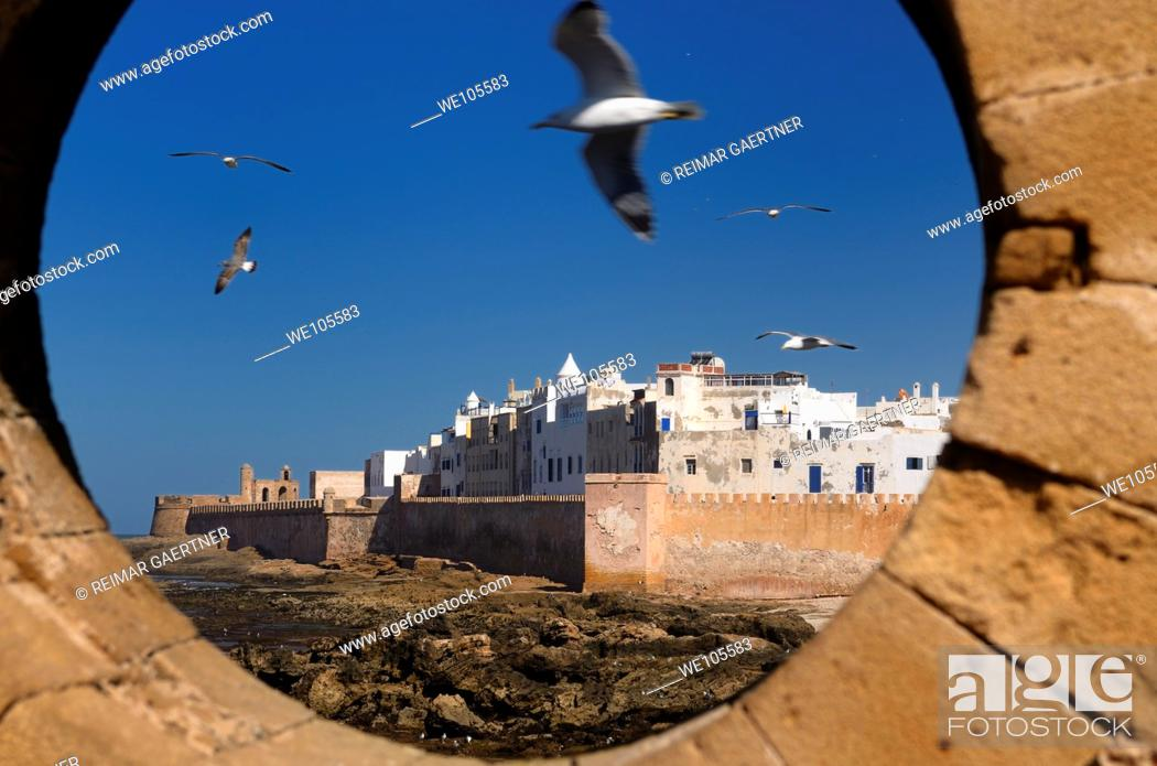 Stock Photo: North bastion and ramparts of Essaouira Morocco viewed from Sqala du Port keyhole window.