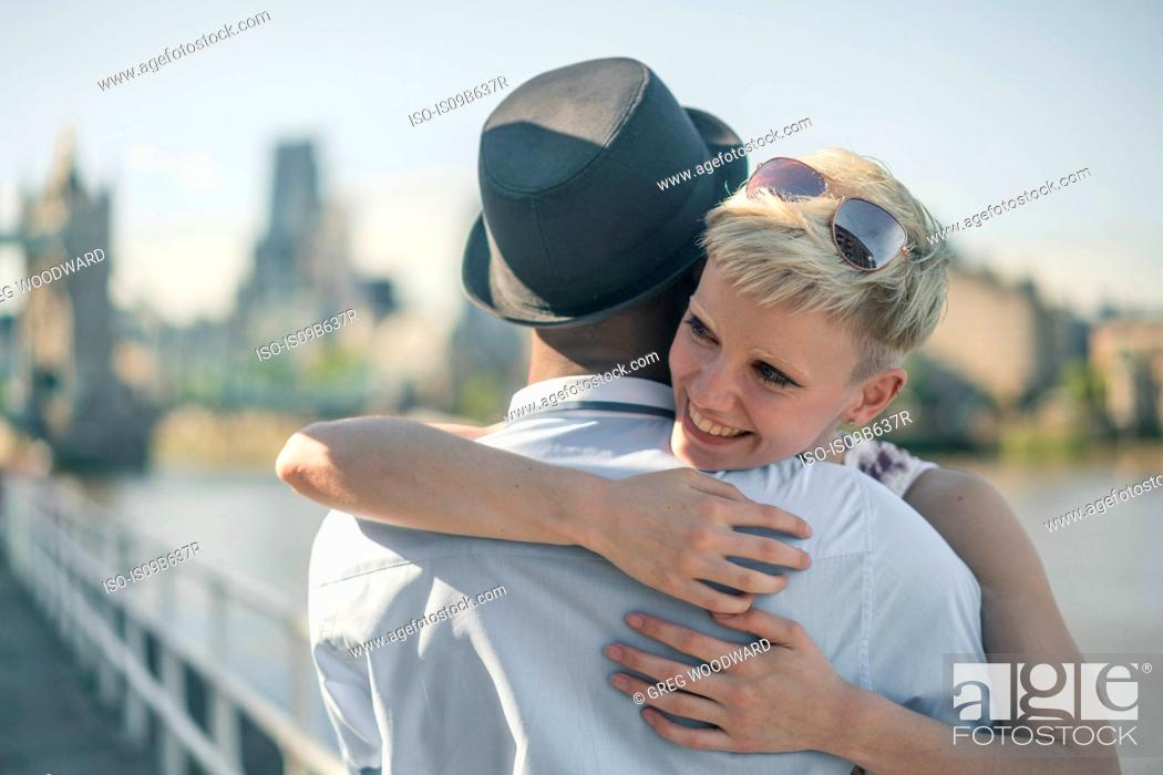 Stock Photo: Young couple outdoors, hugging.