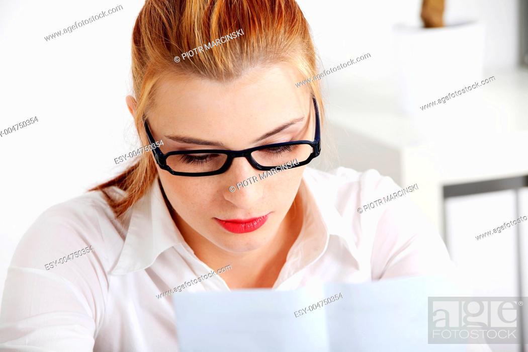 Stock Photo: Closeup on woman reading files.
