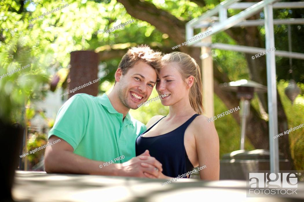 Stock Photo: Germany, North Rhine Westphalia, Duesseldorf, Couple holding hands, smiling.