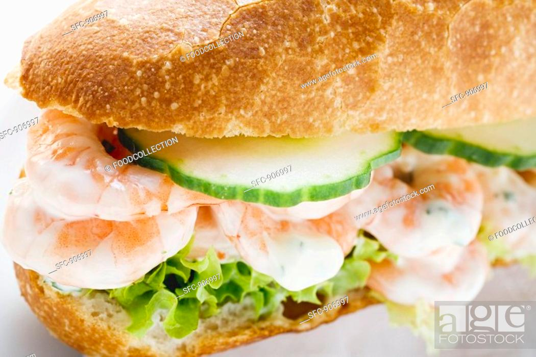 Stock Photo: Shrimps in baguette roll.