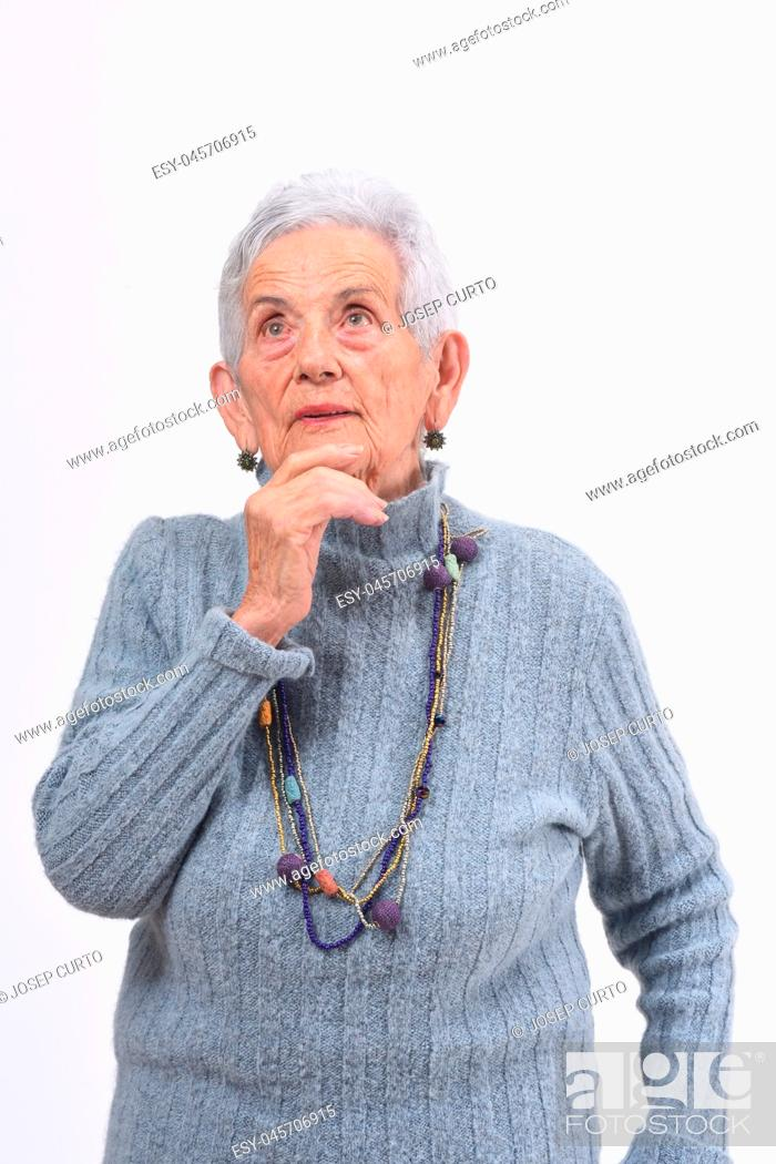 Photo de stock: thoughtful senior woman looking up on a white background.
