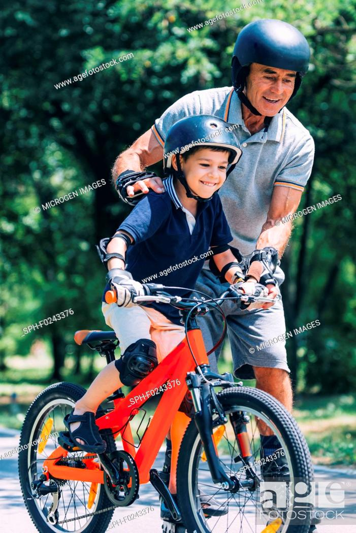 Stock Photo: Learning how to ride a bike.