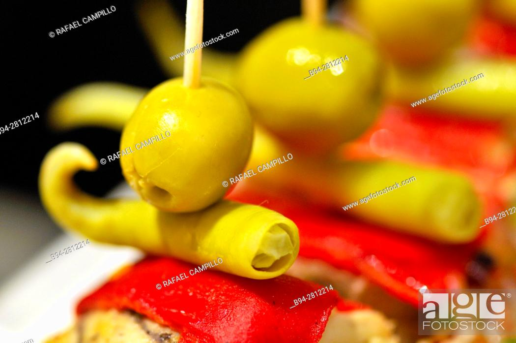 Stock Photo: Olives and pepper. Pintxos or Tapas. Food very Typical in the Basque country. Spain.