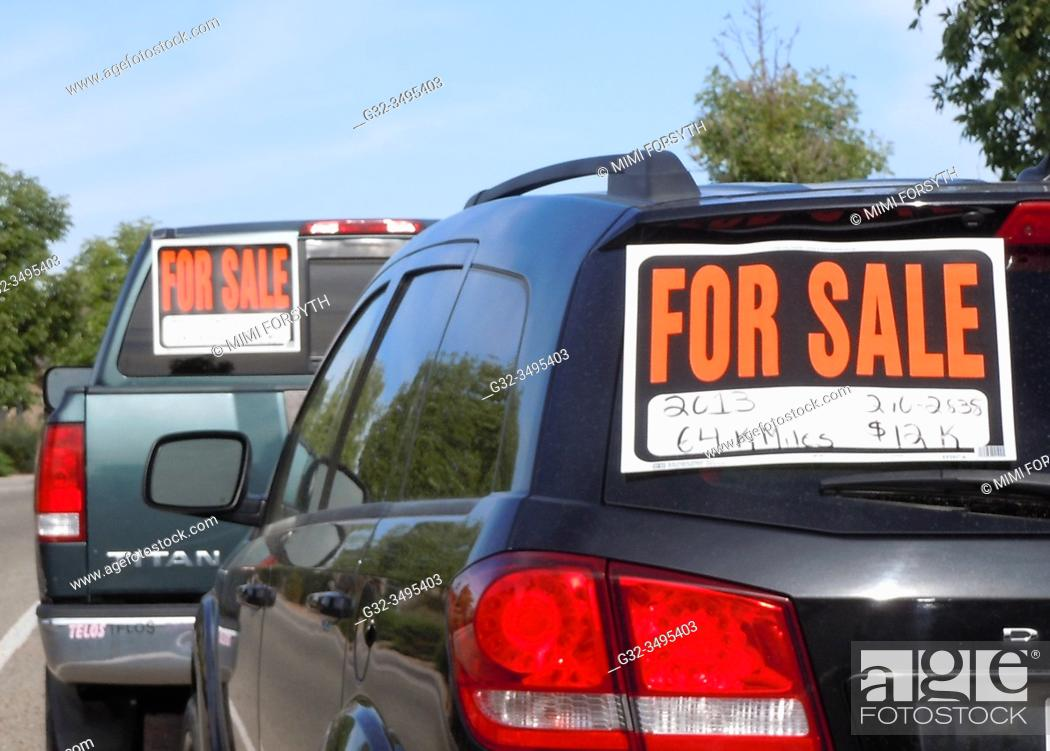 Stock Photo: two cars for sale, New Mexico.