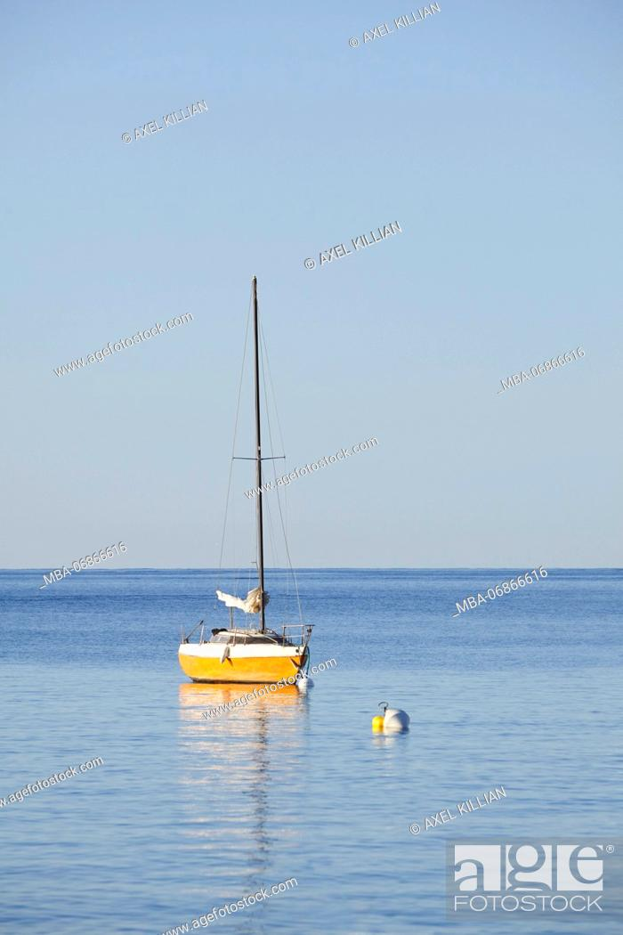Stock Photo: small sailboats with buoy anchoring in the sea.