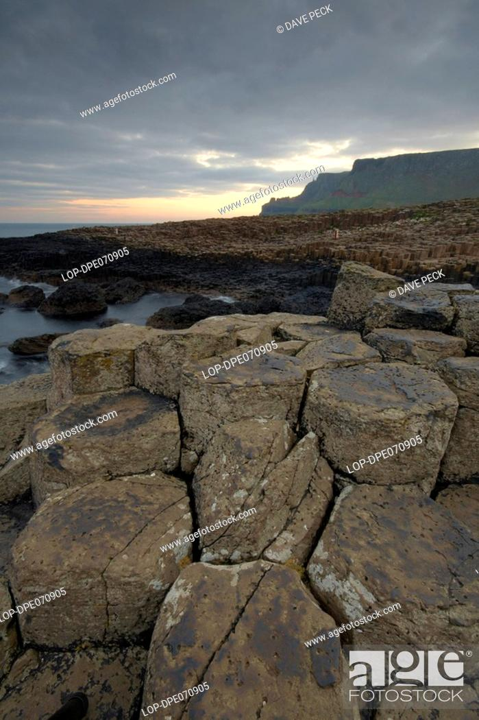 Stock Photo: Northern Ireland, County Antrim, Giants Causeway, Interlocking basalt columns of the Giants Causeway, named as the fourth natural wonder in the UK.