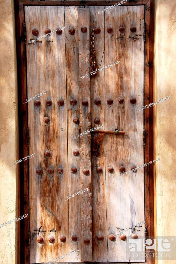 Stock Photo: Old wooden door in Bab al Shams, Dubai, UAE.