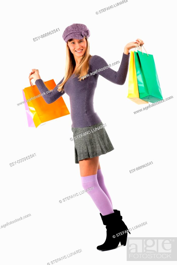 Stock Photo: Beautiful young woman with shopping bags, isolated on white.