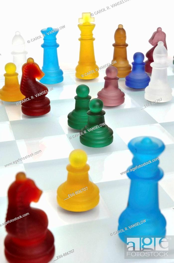 Stock Photo: chessboard with multi-coloured players.