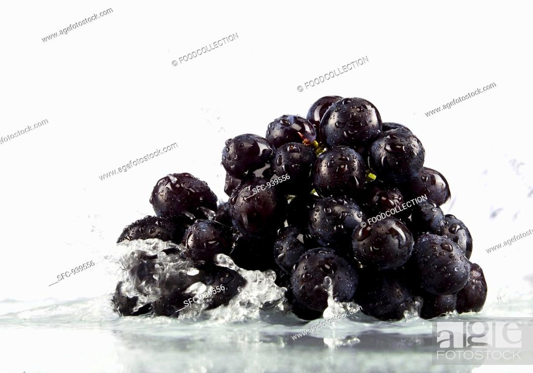 Stock Photo: Red grapes in water.