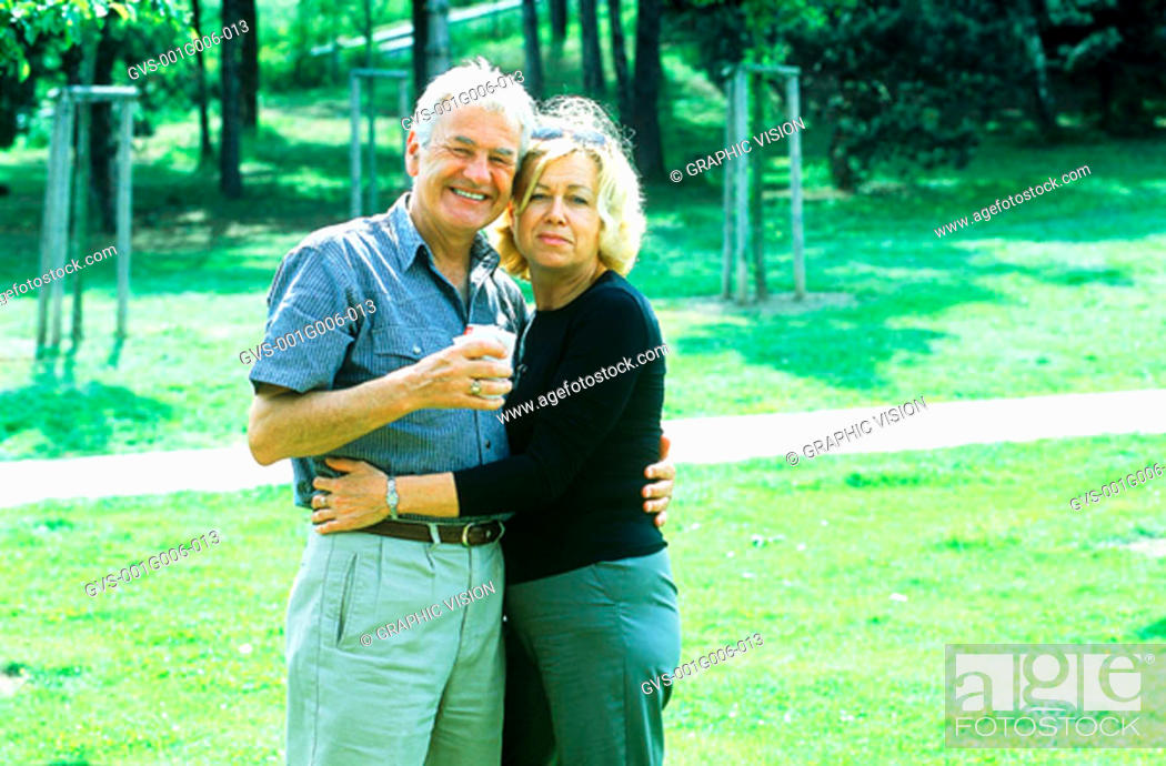 Stock Photo: Portrait of mature couple standing in a garden.
