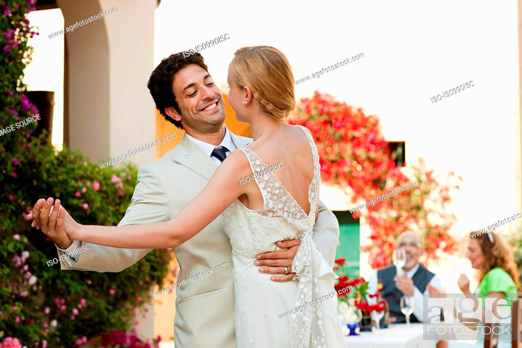 Stock Photo: Newlyweds dancing at wedding reception.