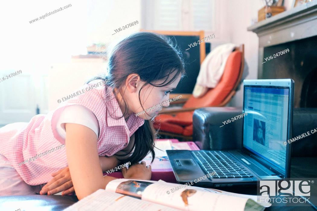 Stock Photo: Portrait of little girl at the computer.