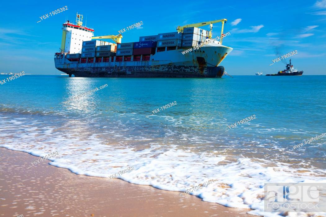 Stock Photo: adrift ship in el saler beach.