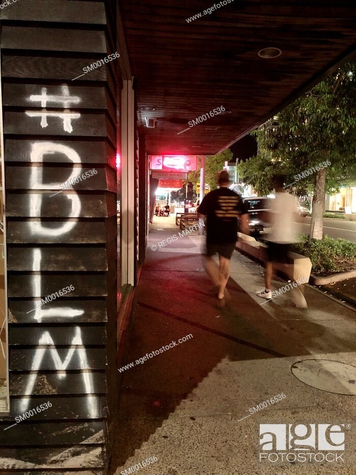 Stock Photo: BLM Black Lives Matter hostage graffiti in a street of Darwin in the Northern Territory of Australia.