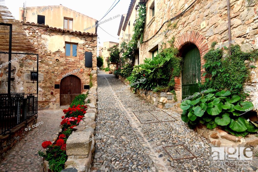 Stock Photo: street of old town of Tossa de Mar, Girona province, Catalonia, Spain.