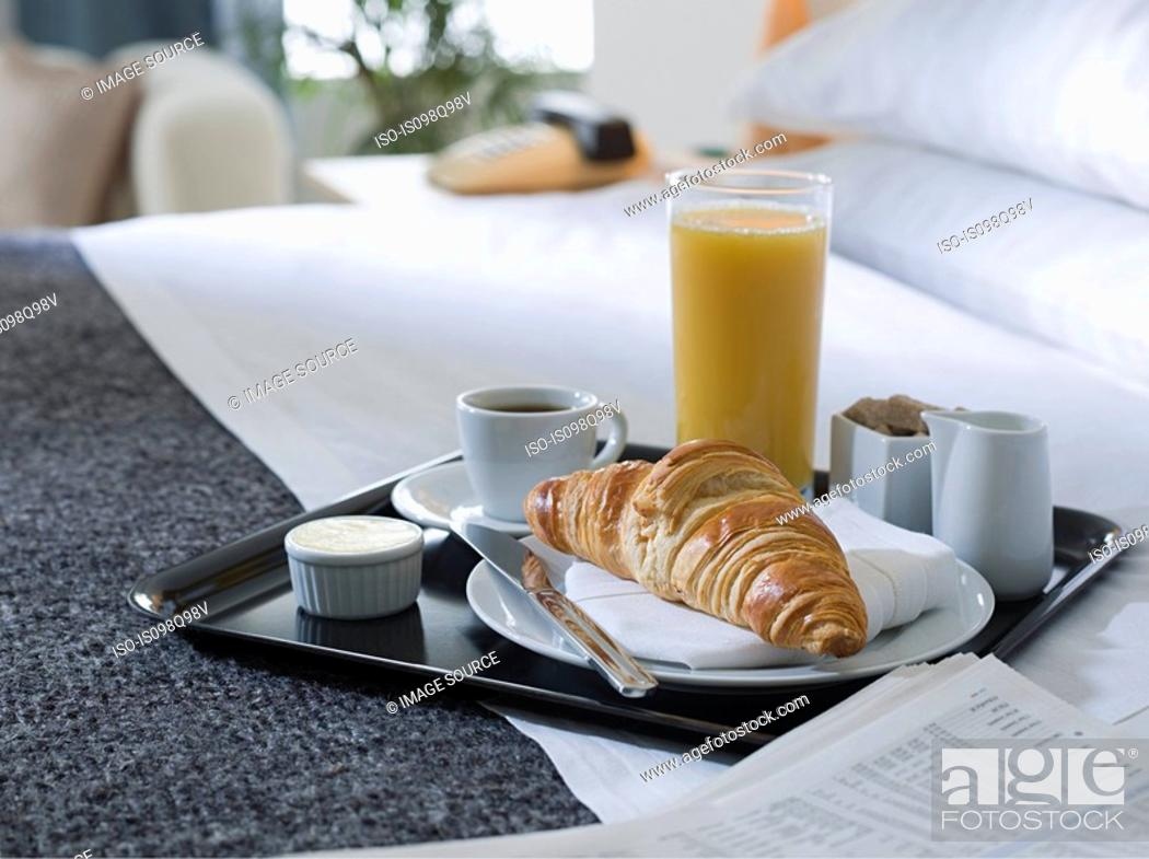 Stock Photo: Breakfast tray on a hotel bed.