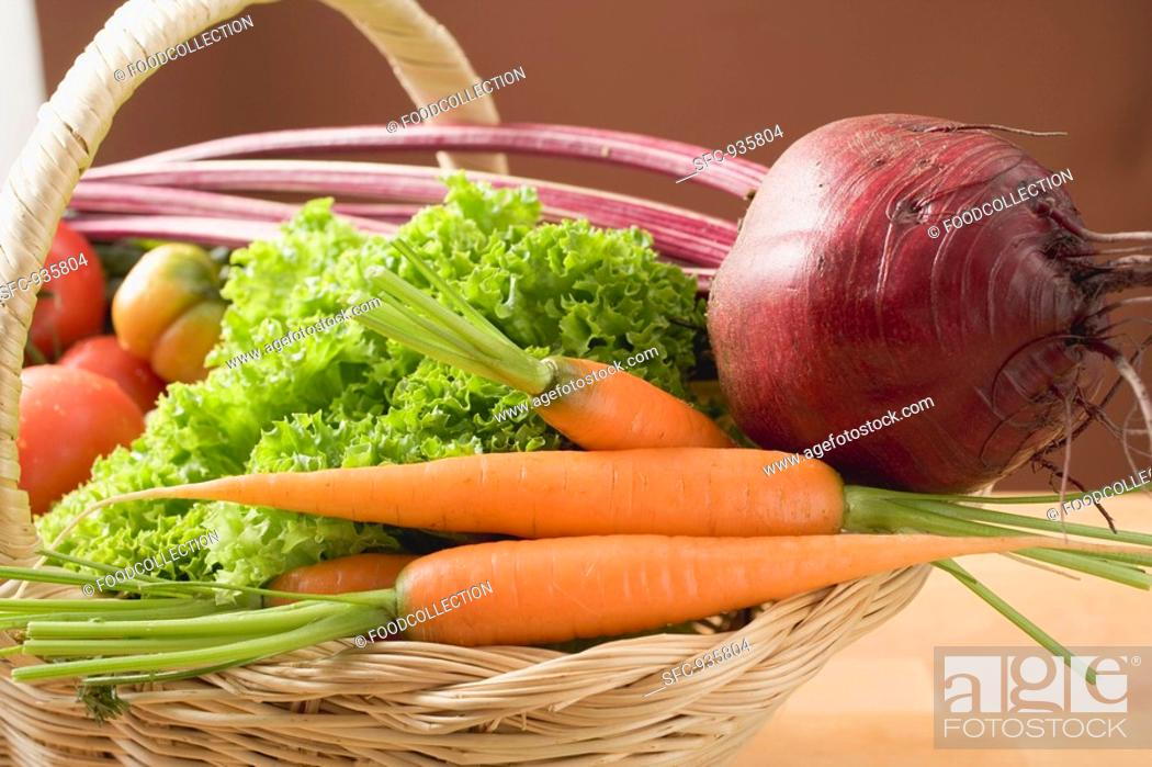 Stock Photo: Fresh carrots, beetroot, lettuce and tomatoes in basket.