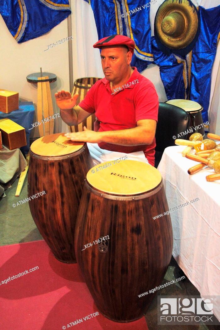 Stock Photo: Musician playing bongo drums.