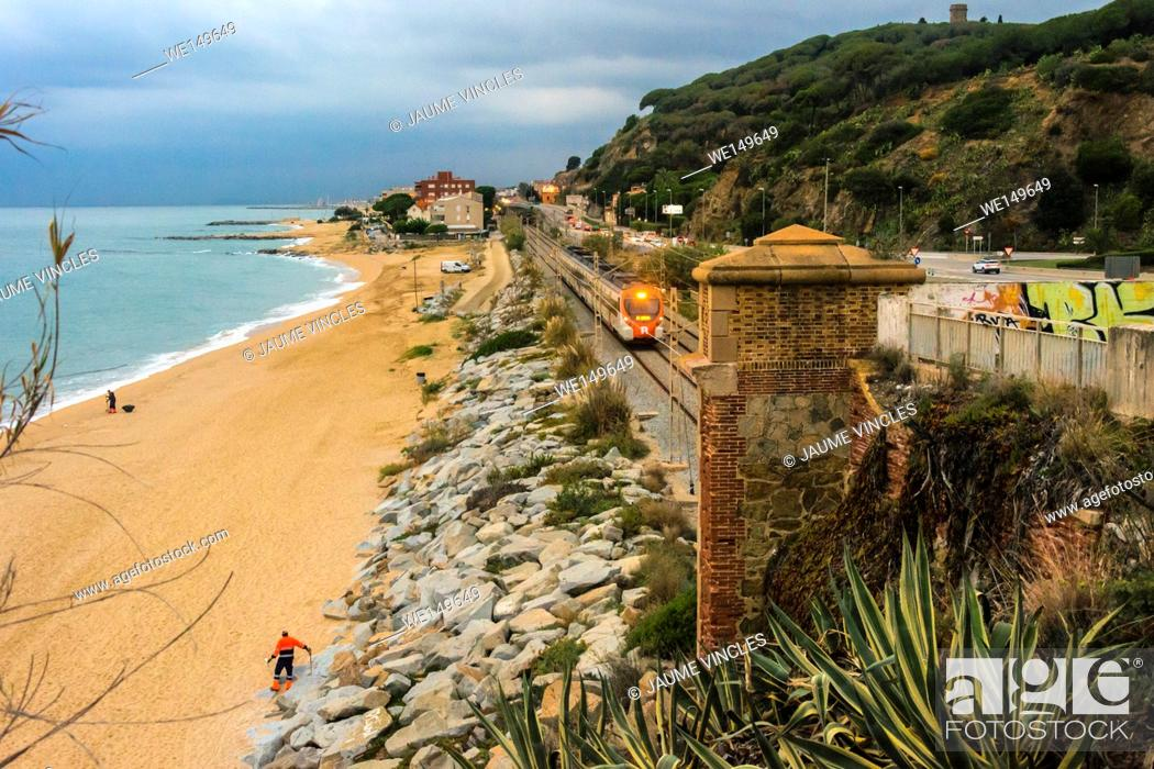 Stock Photo: Commuter train leaving Caldes d'Estrac, Maresme, Barcelona Province, Spain.