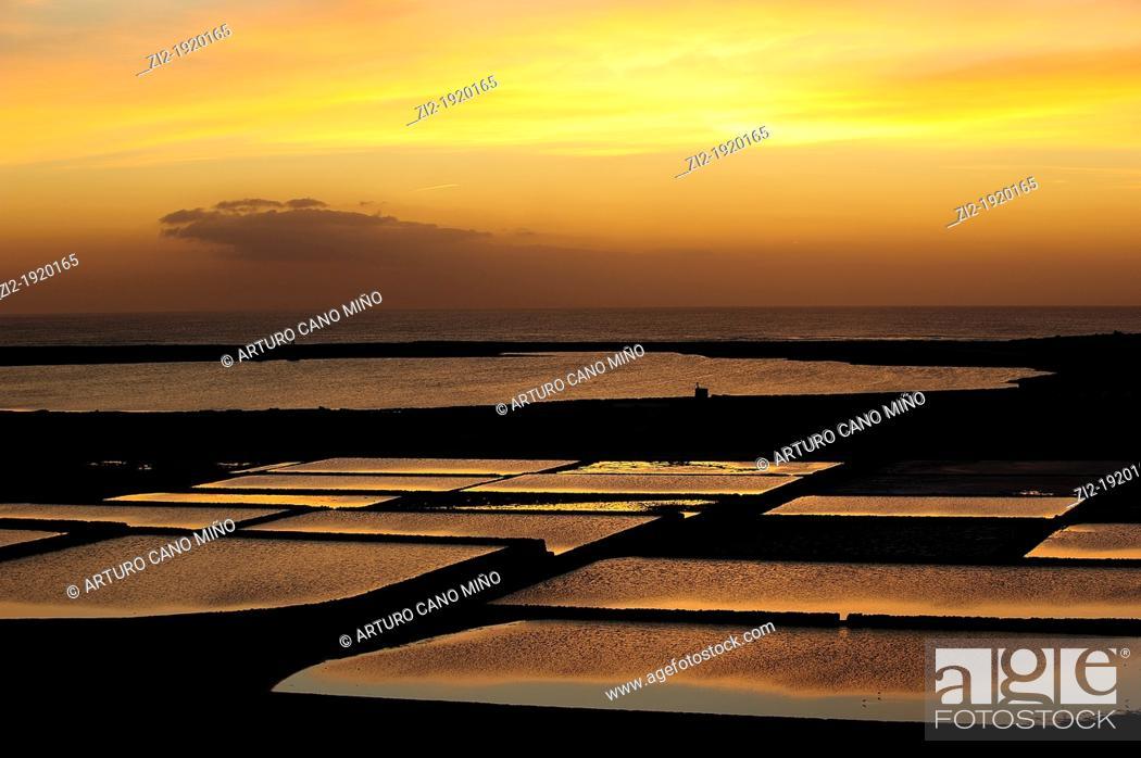 Stock Photo: Sunset in Salinas Janubio, on the island of Lanzarote. Canary Islands, Spain.