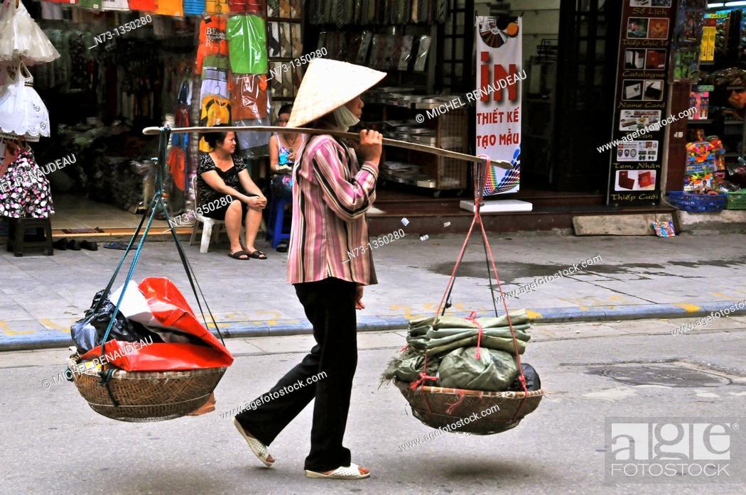 Stock Photo: Vietnam, Hanoi old town market scene.