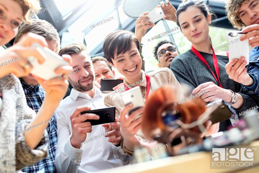 Stock Photo: Group with camera phones at technology conference.