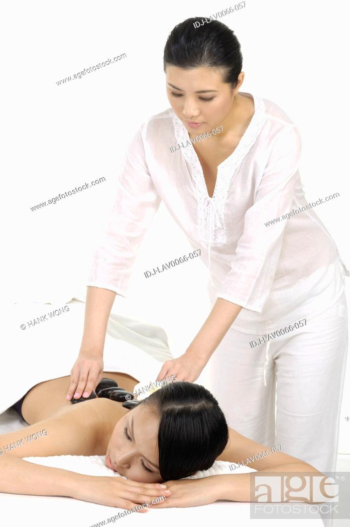 Stock Photo: Young woman getting lastone therapy.