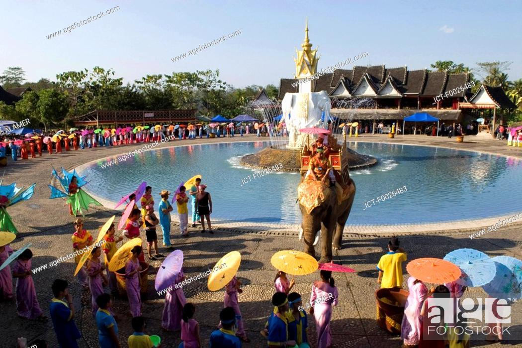 Stock Photo: China, Yunnan, Xishuangbanna, near Jinghong, Dai Minority Park, during Water Splashing Festival.