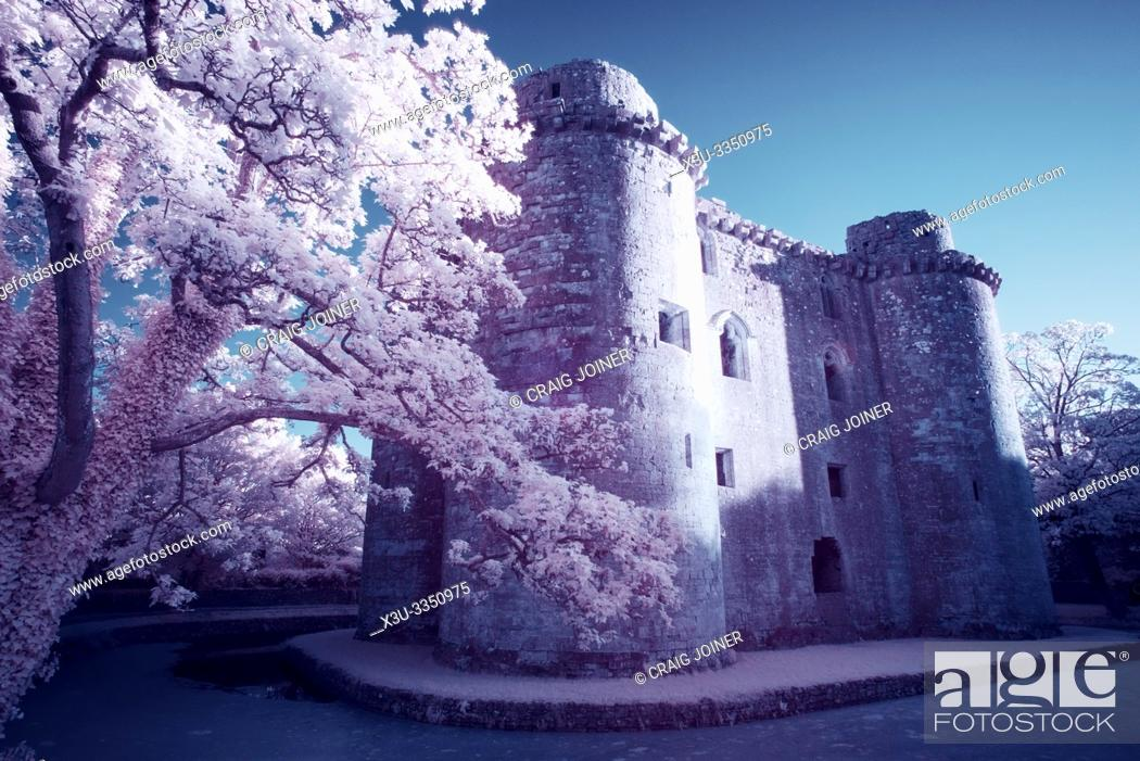 Stock Photo: A false colour infrared image of Nunney Castle and moat in the village of Nunney, Somerset, England.
