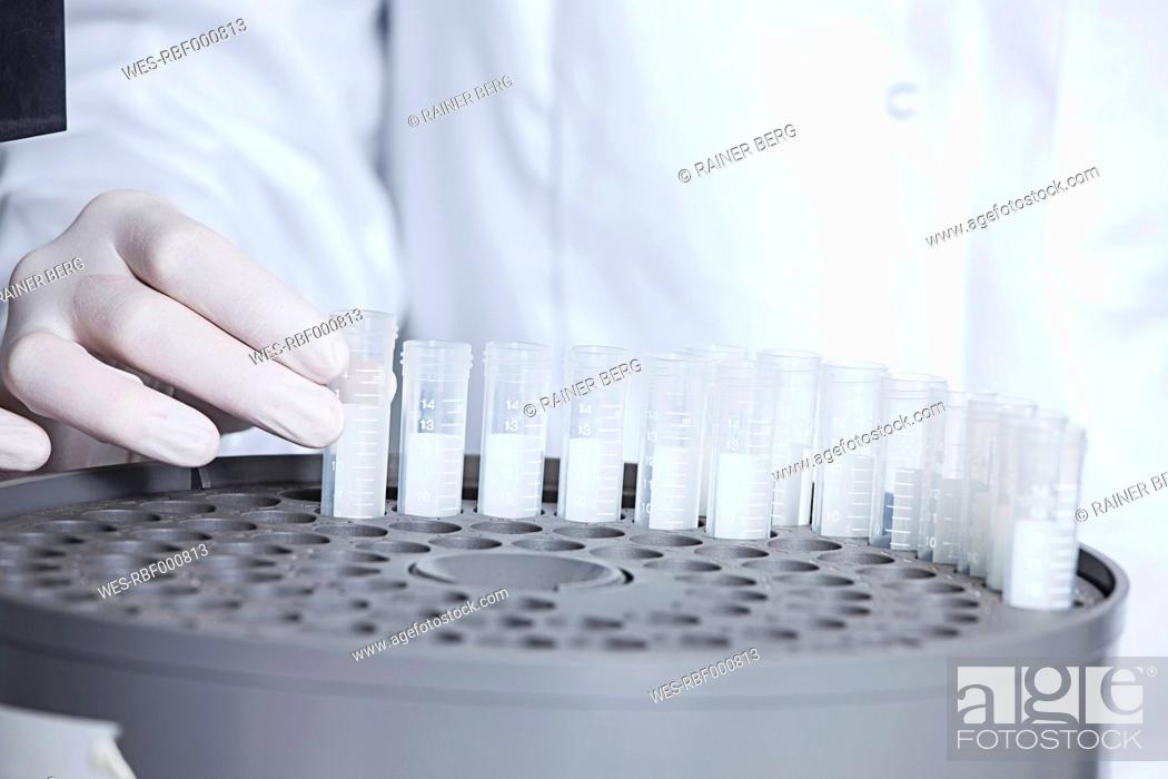 Stock Photo: Germany, Bavaria, Munich, Scientist holding test tube for medical research in laboratory.