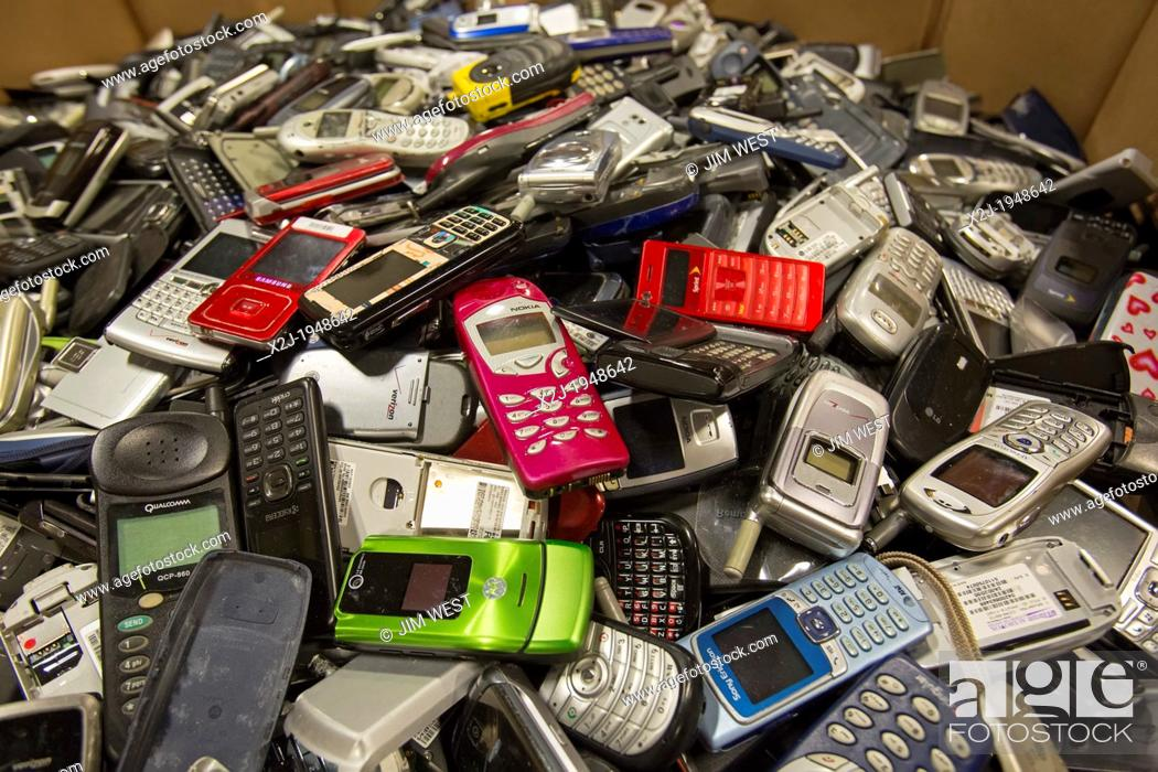 Stock Photo: Dexter, Michigan - Cell phone recycling at ReCellular, Inc. The company collects used phones, inspects and repairs them, and resells them.