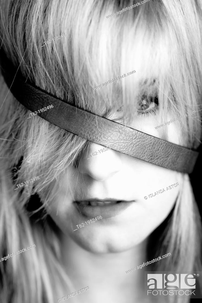 Stock Photo: Close-up portrait of a beautiful young blonde. White and black.