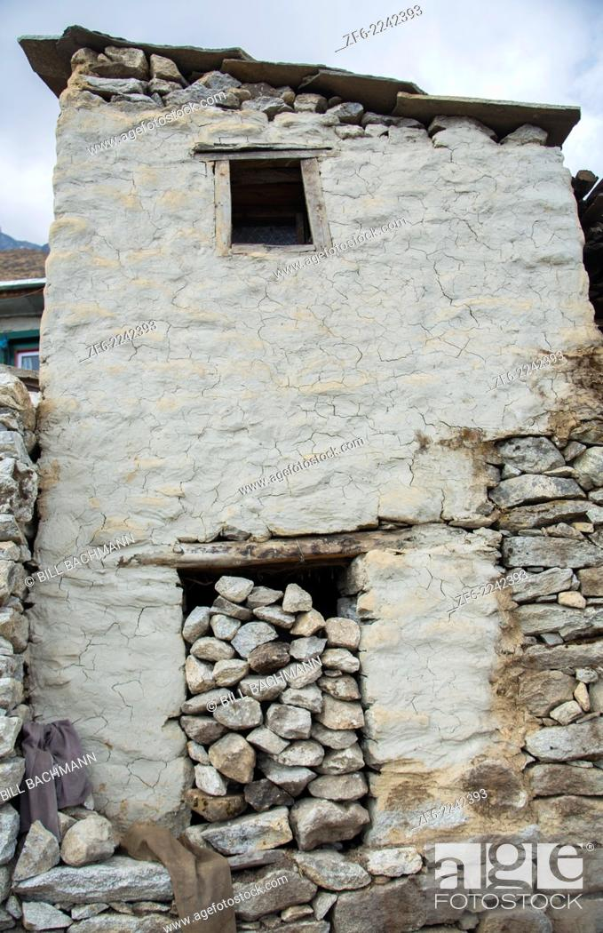 """Stock Photo: Nepal What is called an """"""""old-style"""""""" Sherpa house with its doorway filled with rocks in the village of Khumjung, Solukhumbu, remote, Mt Everest, Himalayas."""