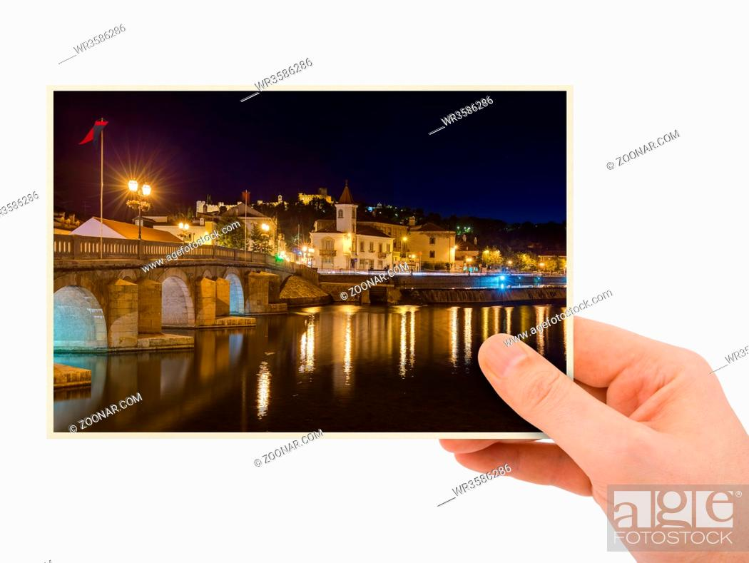 Photo de stock: Hand and Town Tomar - Portugal (my photo) (my photo) isolated on white background.