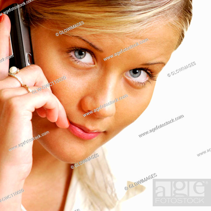 Stock Photo: Portrait of a businesswoman talking on a mobile phone.