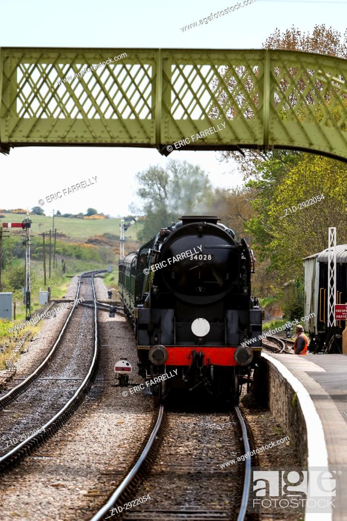 "Stock Photo: """"""""""Eddystone"""" steam locomotive working on the Swanage Railway. England. Arriving Corfe Station UK."