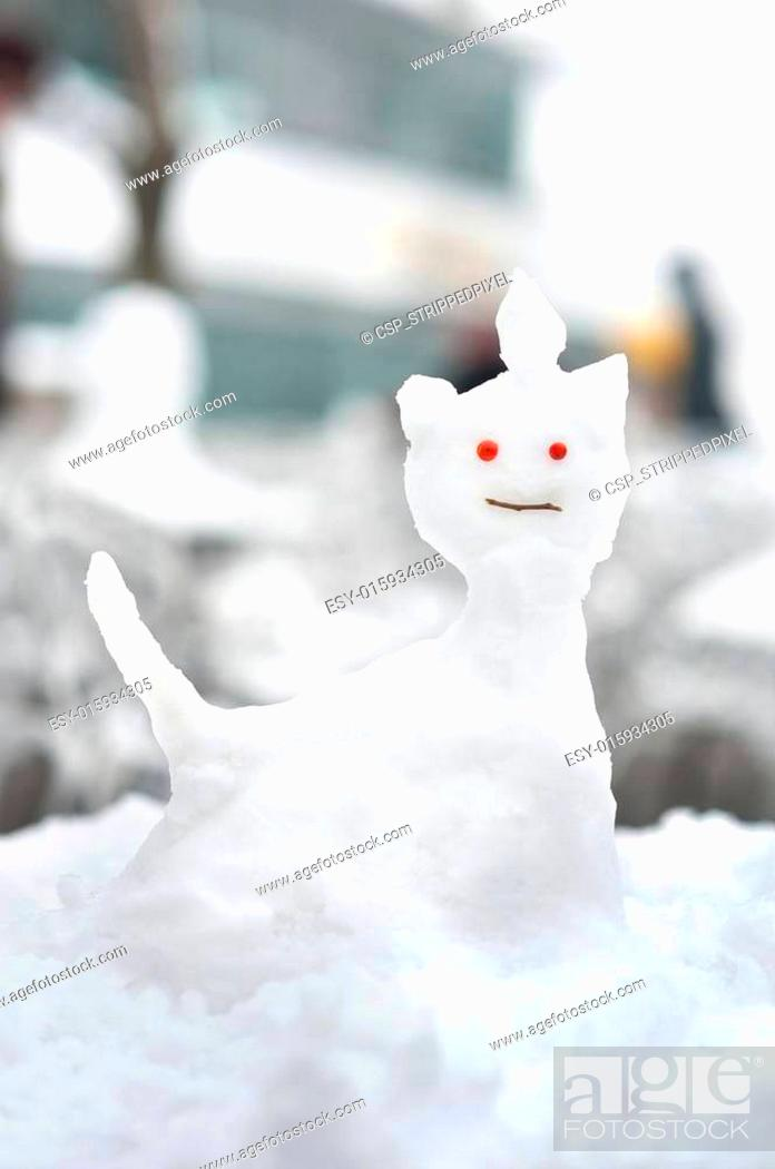Stock Photo: Small snow sculpture in the shape of a cat.