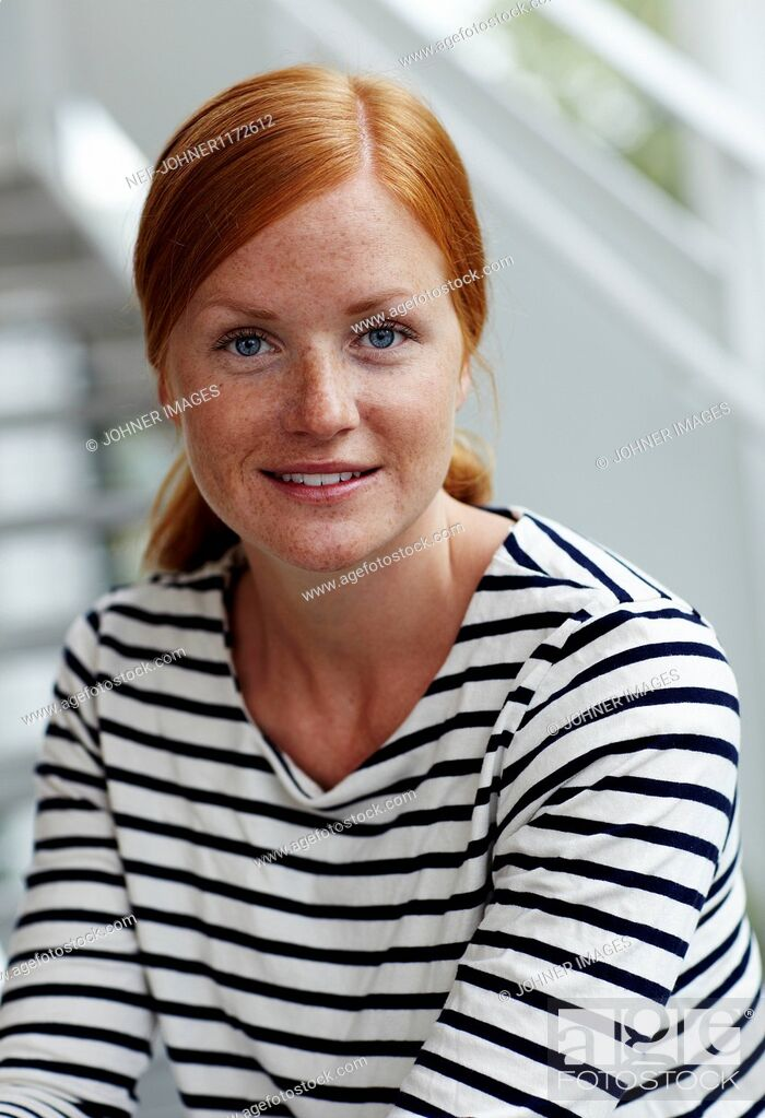 Stock Photo: Portrait of young redhead woman.