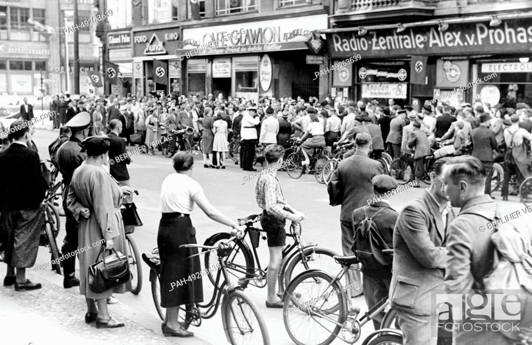 Stock Photo: The photo from a Nazi news report shows a crowd of people outside of the Radio-Zentrale Alex von Prohaska during the special announcement about the French.