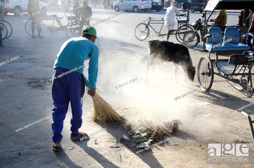 Sweeper cleaning road in Jaipur at Rajasthan India, Stock
