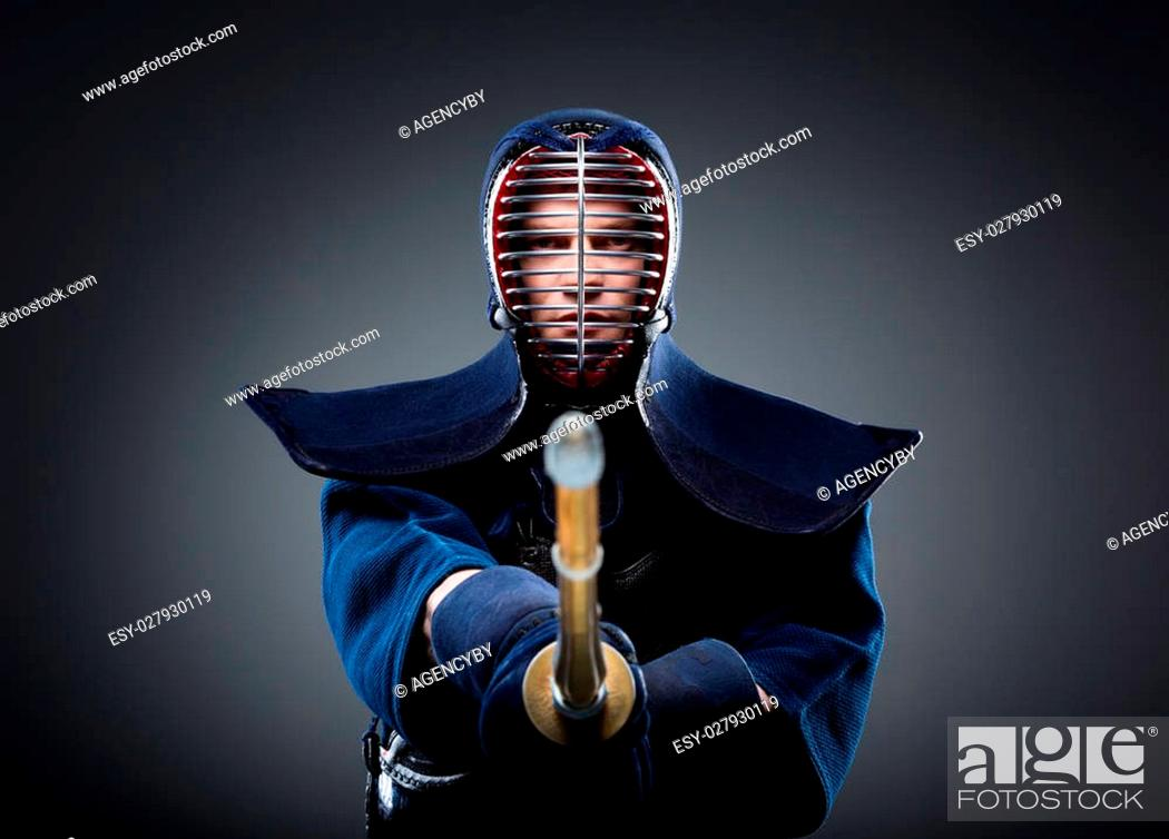 Portrait of kendo fighter with bokuto  Japanese martial art of sword