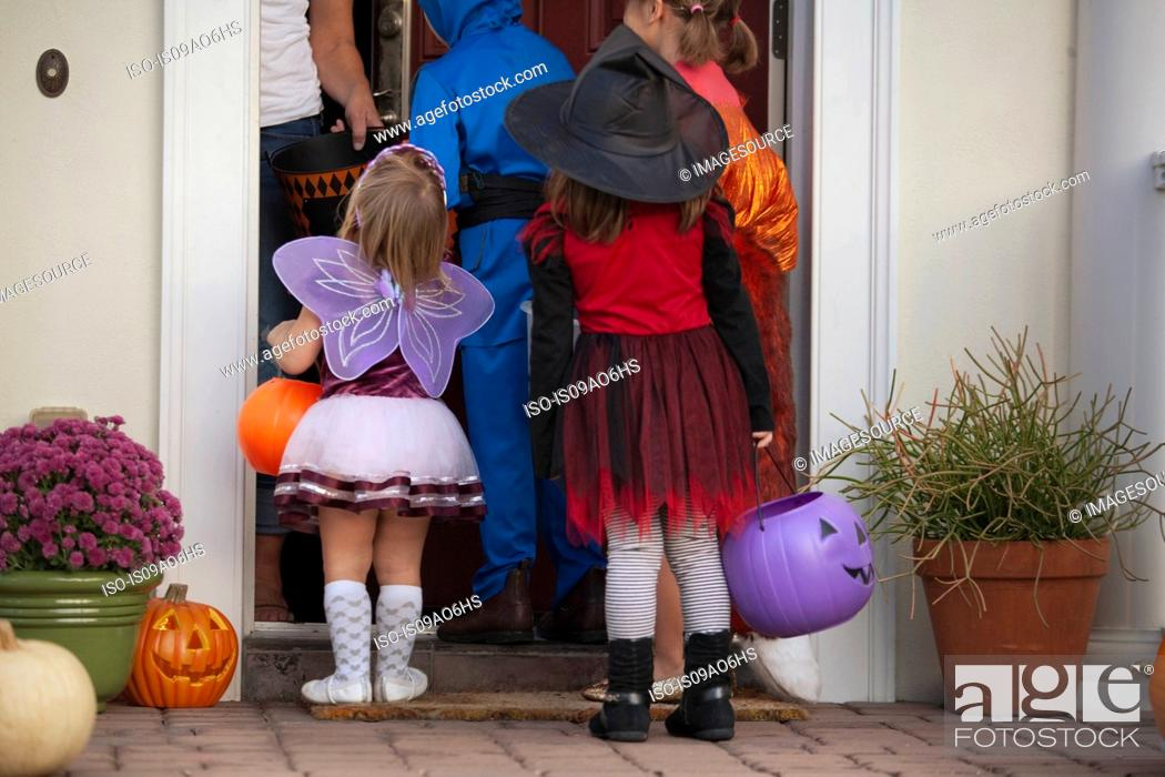 Stock Photo: Children trick or treating.