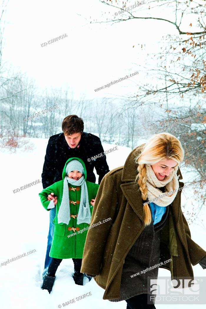 Stock Photo: Family walking in snow.