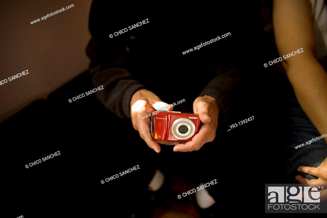Stock Photo: A blind male student touches a camera.