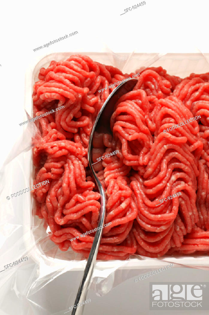 Stock Photo: Fresh minced beef in plastic container with spoon.