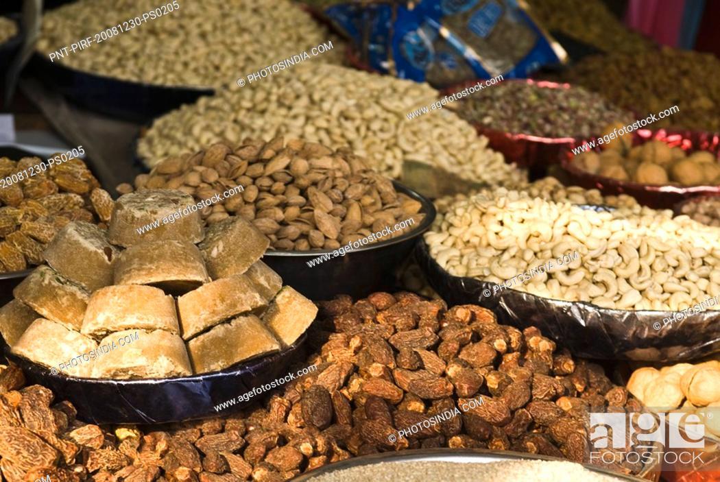 Stock Photo: Close-up of dry fruits at a market stall, Delhi, India.
